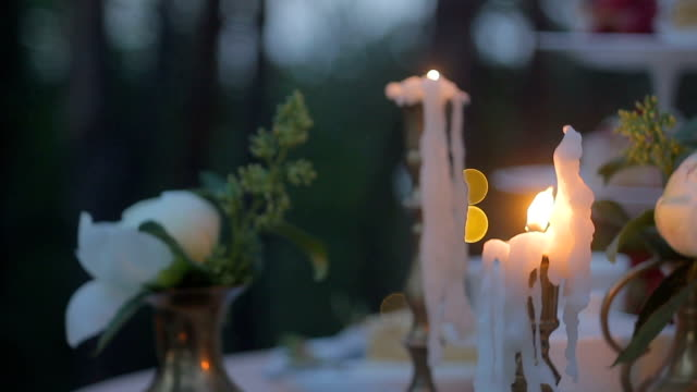 candles on the table in the forest video