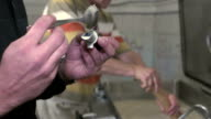 Candy maker using refractometer measuring percentage of sugar in mixture video