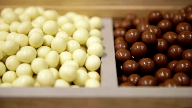Candy shop. Nuts in white and dark chocolate video