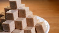 Cane sugar cubes in rotation video