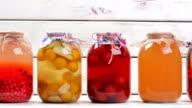 Canned fruit drinks in glass jars. video