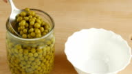 Canned peas in pot. video