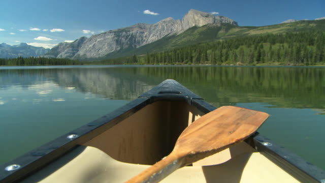 Canoe and paddle on mountain lake video