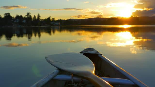 Canoe on Lake, Nature Adventure, Dusk Sunset on Still Ocean Water video