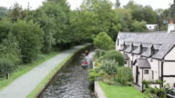 Canoes on Llangollen canal Wales UK popular Welsh tourist attraction video