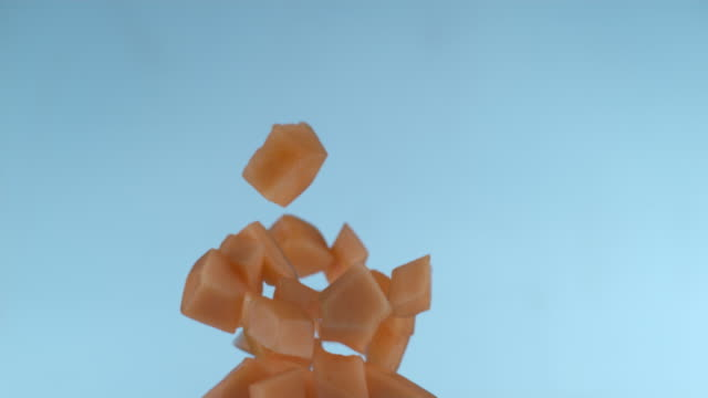 Cantelope pieces flying in slow motion video