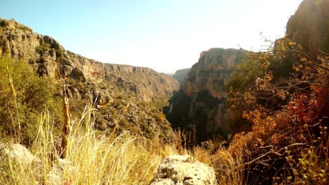 Canyon Gorge Seytanderesi near antique city Adamkayalar winter yellow grass blue sky Mersin province Turkey video