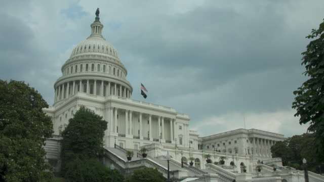 U.S. Capitol Building with POW MIA and American Flags in Washington, DC - in 4k/UHD video