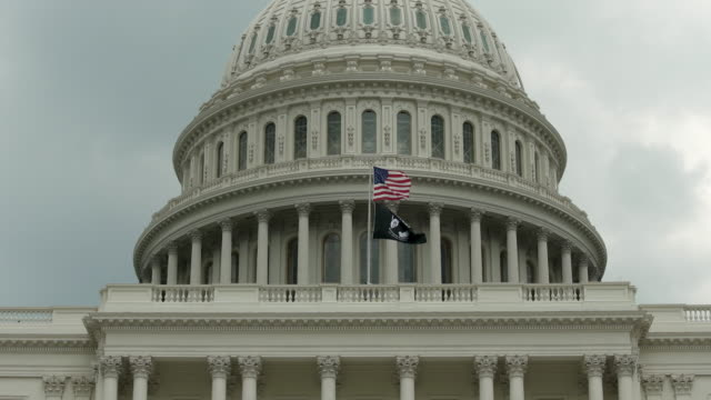 U.S. Capitol Dome with POW MIA and American Flags in Washington, DC - in 4k/UHD video
