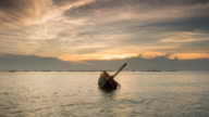 capsize fishing boat on the sea at sunset video