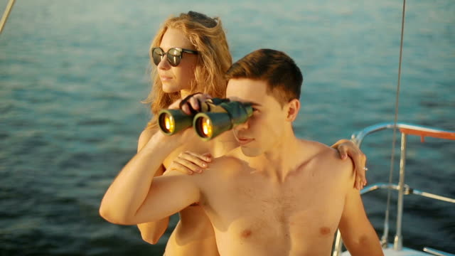 Captain of the yacht looking in binoculars. video