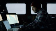 Captain Surrounded by Monitors and Screens with Sea Maps Pilots Commercial Fishing Ship. video