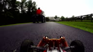 RC Car POV as it races down a road towards a home video