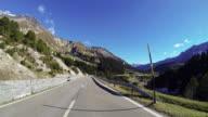 Car ascending mountain pass POV video