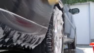 Car Care - Washing a car by hand - sliding camera video