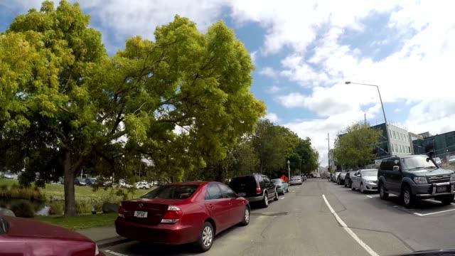 Car drives along Christchurch road, New Zealand video