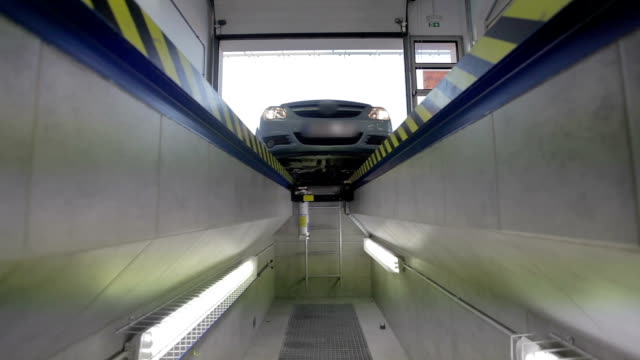 HD: Car drives over gap for annual service video