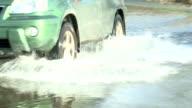 Car drives through flooded road video