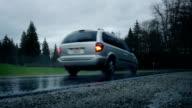 Car Drives Through Park On Rainy Day video