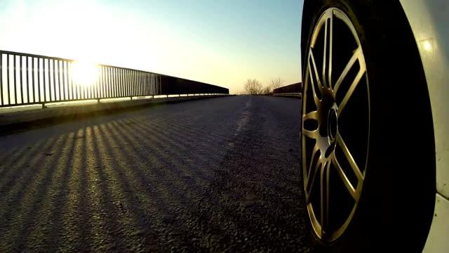 Car driving across country road bridge video
