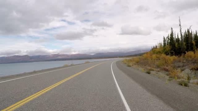 Car driving along mountain road POV video
