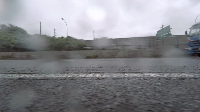 Car driving at rainy day - side view - 4K video