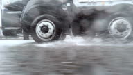 Car driving at rainy day - side view video