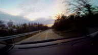 Car driving fast into forest video