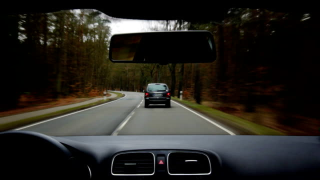 Car driving on country road video