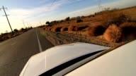 Car driving on deserted road. Car parking on the side of the road video