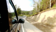 Car driving on forest mountain highway in Altay video