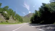 Car driving on high mountain pass POV video