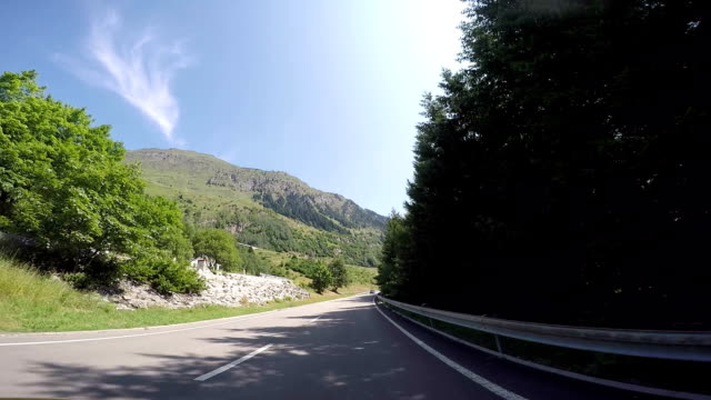 Car driving on high mountain pass POV video