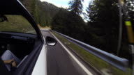 Car driving on mountain road, passenger view video