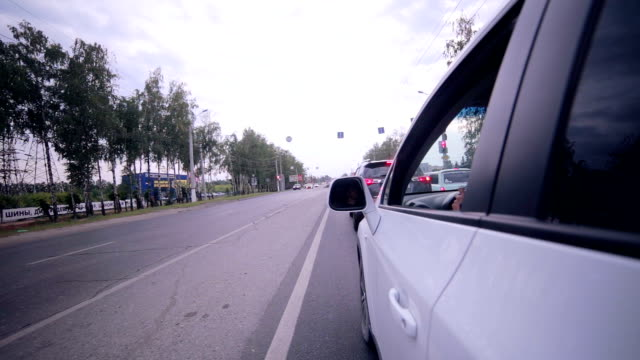 Car driving through road. On board camera video