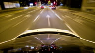 Car driving through the city at night video