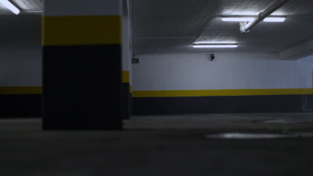 Car entering parking garage, four shots video