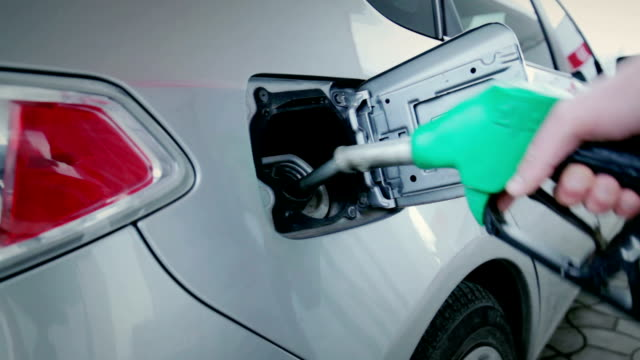 Car filled with fuel at gas station video
