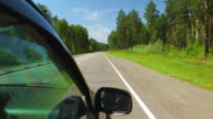 POV: Car is moving across the forest in sunny day on a highway in Altay, Russia video