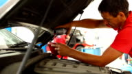 Car mechanic pouring fresh engine oil. video