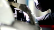 Car mechanic unscrewing device of automobile in service, close up video