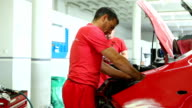 Car mechanics at work video
