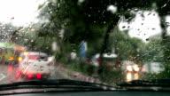 Car moving forward during rainy season video