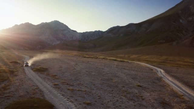 Car offroad adventures on the mountain: drone aerial view video