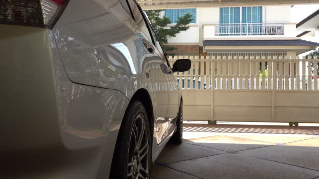 car parked in house garage video