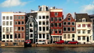 Car Passes Typical Dutch Houses By Canal video