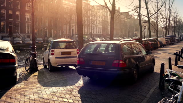 Car Passes Waterfront In The Sun video