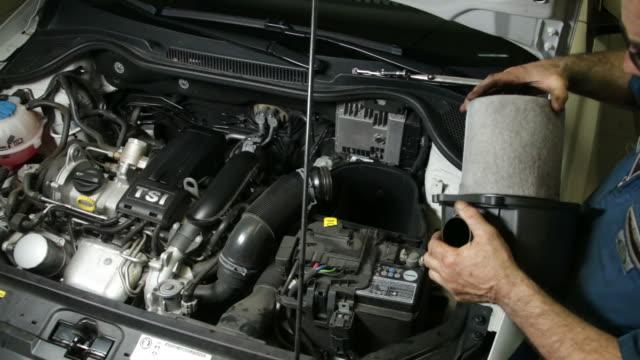 Car Repair Mechanic Assembles Automobile Air Filter video