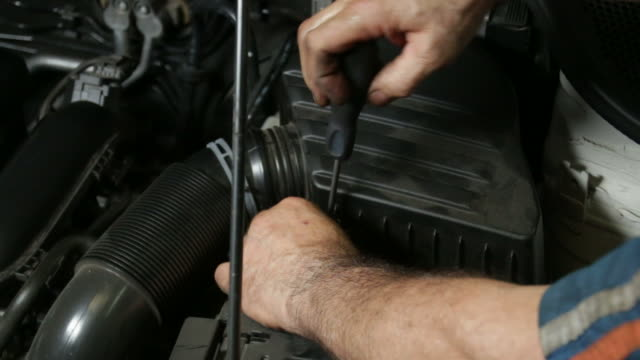 Car Repair Mechanic Screwing Automobile Air Filter video