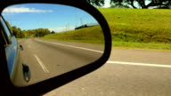 Car Side Mirror. Driving on the freeway day video